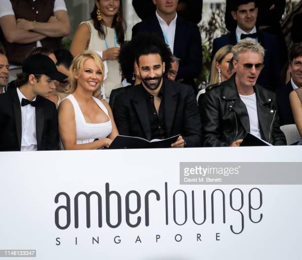 Brandon Thomas Lee Pamela Anderson Adil Rami and Eddie Irvine attend Amber Lounge U*NITE Fashion Monaco 2019 at Le Meridien Beach Plaza Hotel on May...