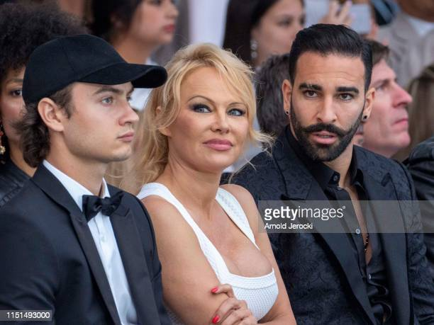 Brandon Thomas Lee Pamela Anderson and Adil Rami attend Amber Lounge 2019 Fashion Show on May 24 2019 in MonteCarlo Monaco