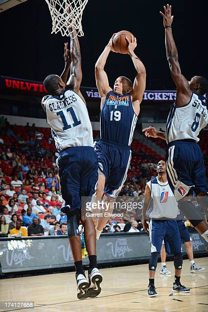 Brandon Triche of the Charlotte Bobcats goes to the basket against Mickell Gladness and DominiqueSutton of the D-League Select Team during NBA...