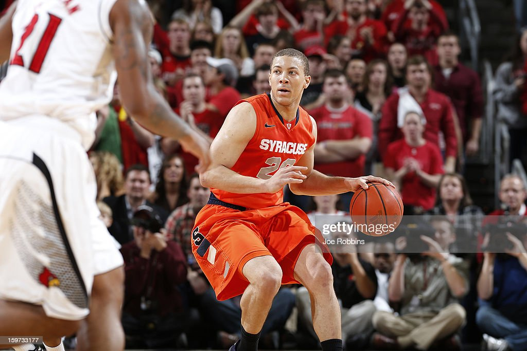 Brandon Triche #20 of the Syracuse Orange brings the ball up court against pressure from the Louisville Cardinals during the game at KFC Yum! Center on January 19, 2013 in Louisville, Kentucky. Syracuse defeated Louisville 70-68.