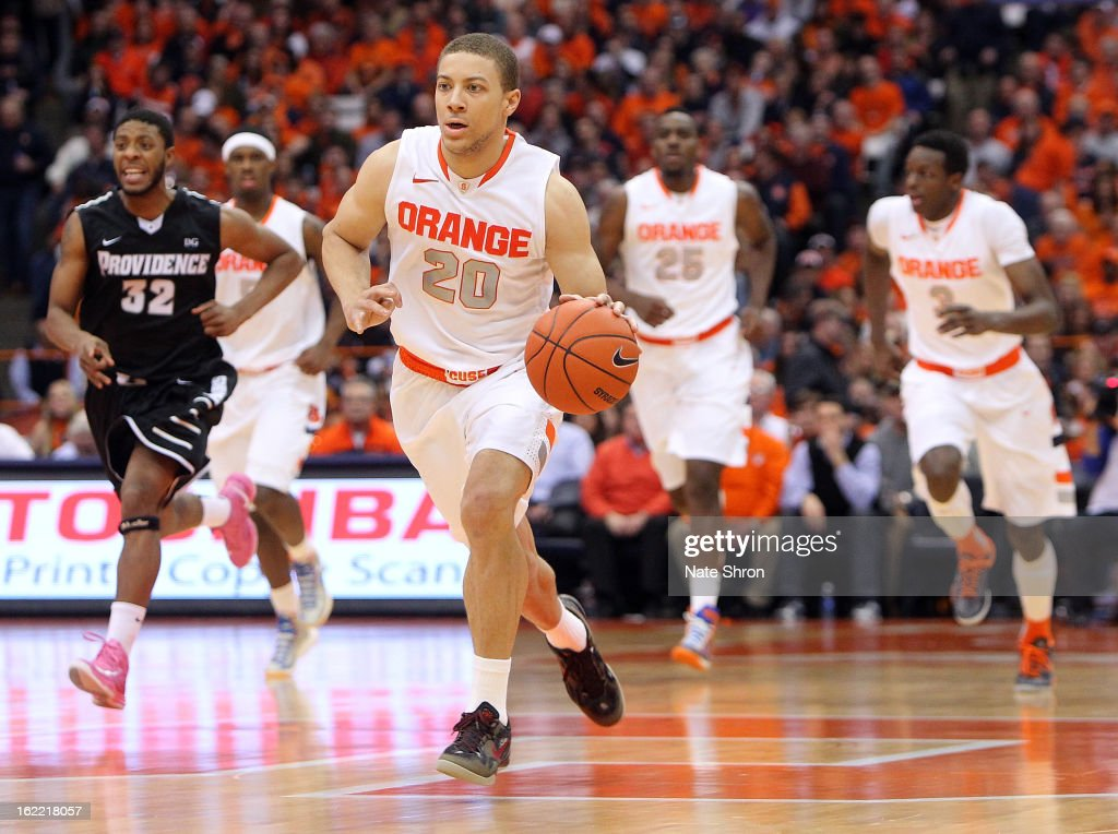 Brandon Triche #20 of the Syracuse Orange drives the ball upcourt as Vincent Council #32 of the Providence Friars follows during the game at the Carrier Dome on February 20, 2013 in Syracuse, New York.
