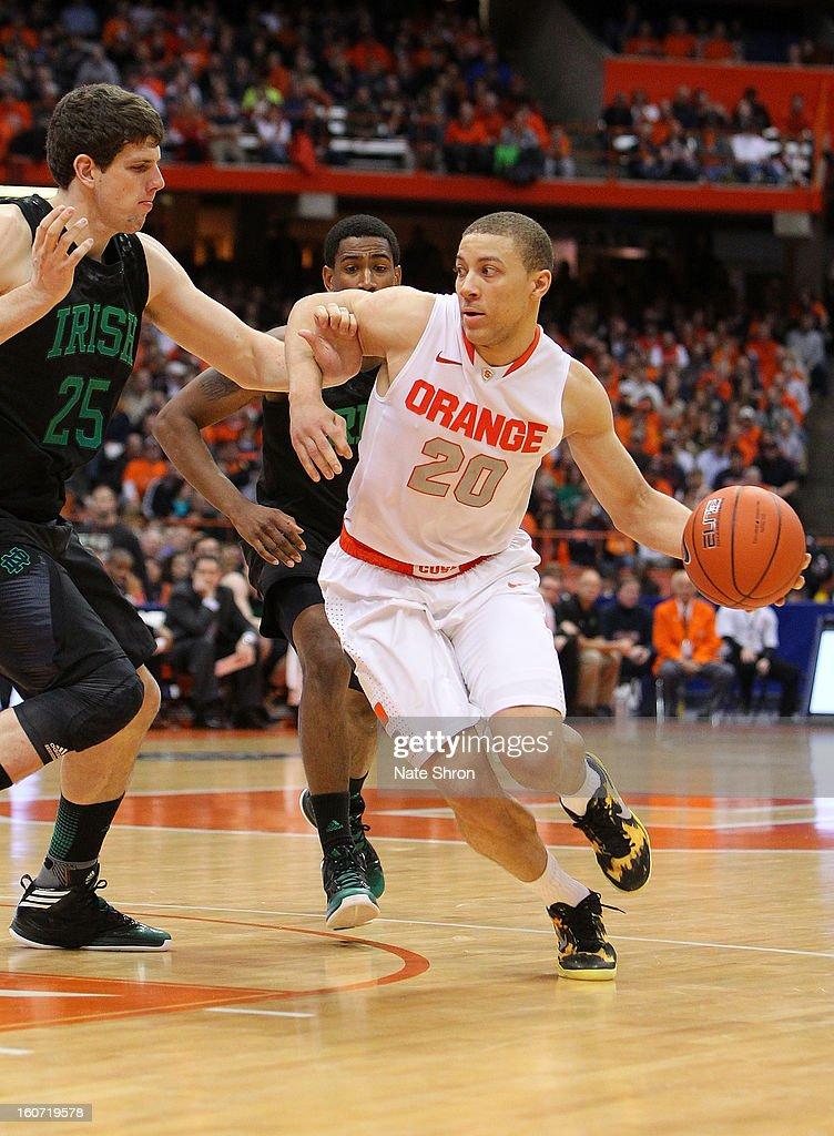Brandon Triche #20 of the Syracuse Orange drives to the basket against Tom Knight #25 of the Notre Dame Fighting Irish during the game at the Carrier Dome on February 4, 2013 in Syracuse, New York.