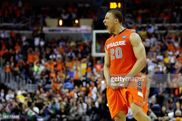 Brandon Triche of the Syracuse Orange reacts towards the end of the game against the Marquette Golden Eagles during the East Regional Round Final of...