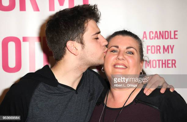 Brandon Tyler Russell poses with his mother Desiree Russell at a luncheon in honor of Mother's Day for the release of Pamela L Newton's 'A Candle For...