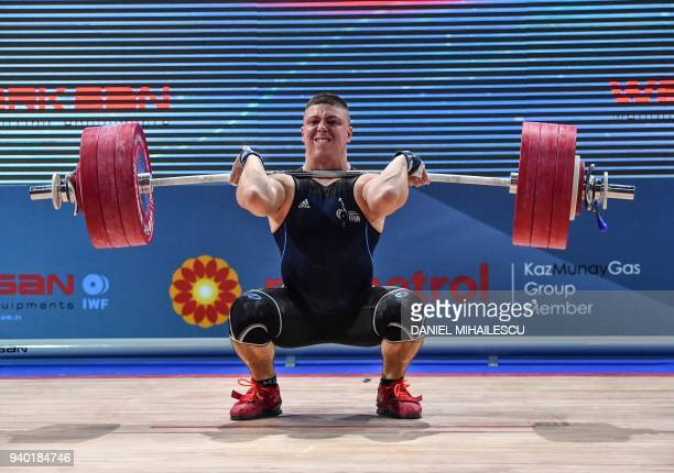 Brandon Vautard of France lifts during the men Senior 85kg category of the European Weightlifting Championship in Izvorani, March 30, 2018. / AFP...
