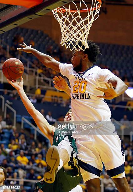 Brandon Watkins of the West Virginia Mountaineers defends against Zane Waterman of the Manhattan Jaspers at the WVU Coliseum on November 28 2016 in...