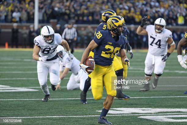 Brandon Watson of the Michigan Wolverines returns 62 yards for a third quarter touchdown during the game against the Penn State Nittany Lions at...