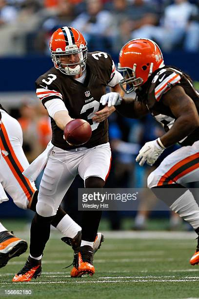 Brandon Weeden makes a handoff to Trent Richardson of the Cleveland Browns during a game against the Dallas Cowboys at Cowboys Stadium on November 18...