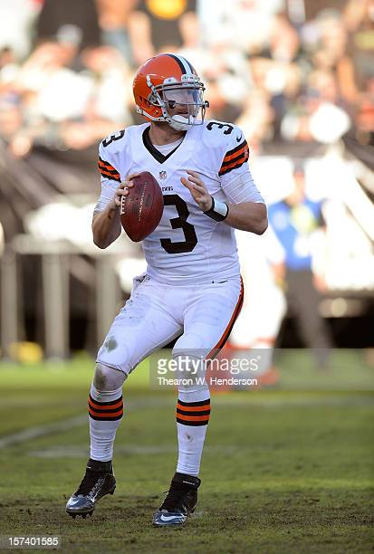 Brandon Weeden of the Cleveland Browns drops back to pass against the Oakland Raiders during the third quarter at OaklandAlameda County Coliseum on...
