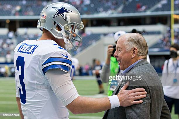 Brandon Weeden of the Dallas Cowboys talks with T Boone Pickens on the sidelines before a game against the Arizona Cardinals at ATT Stadium on...