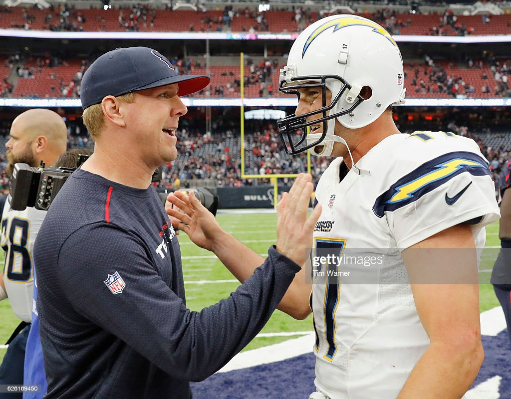 Brandon Weeden #5 of the Houston Texans greets Philip Rivers #17 of the San Diego Chargers after the game at NRG Stadium on November 27, 2016 in Houston, Texas.