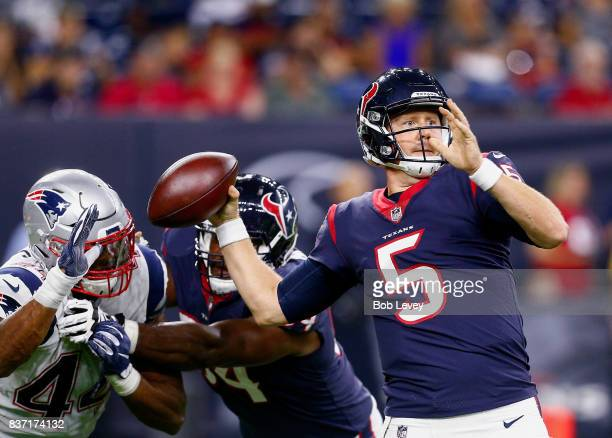 Brandon Weeden of the Houston Texans is pressured by Trevor Bates of the New England Patriots in a preseason game at NRG Stadium on August 19 2017 in...
