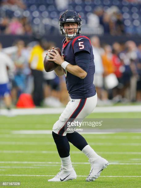Brandon Weeden of the Houston Texans throws a pass during warm ups before playing the New England Patriots in a preseason game at NRG Stadium on...