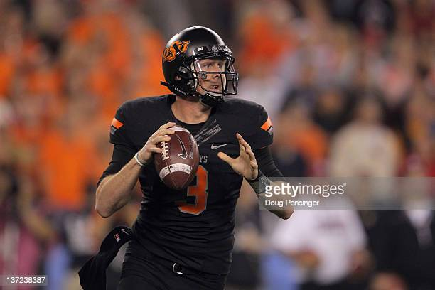 Brandon Weeden of the Oklahoma State Cowboys throws a pass against the Stanford Cardinal during the Tostitos Fiesta Bowl on January 2 2012 at...