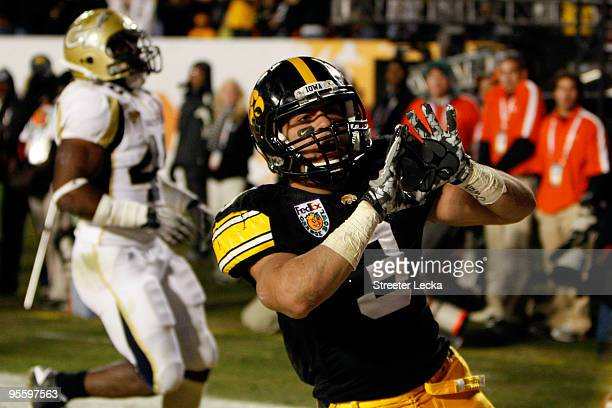 Brandon Wegher of the Iowa Hawkeyes celebrates after he scored a 32yard rushing touchdown late in the fourth quarter against the Georgia Tech Yellow...