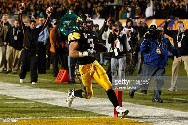 Brandon Wegher of the Iowa Hawkeyes scores a 32-yard rushing touchdown late in the fourth quarter against the Georgia Tech Yellow Jackets during the...
