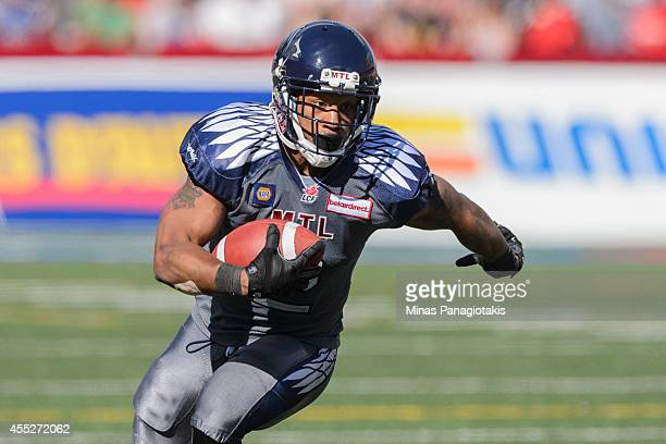 Brandon Whitaker of the Montreal Alouettes carries the ball during the CFL game against the Hamilton TigerCats at Percival Molson Stadium on...
