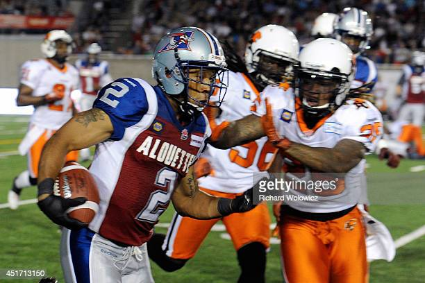 Brandon Whitaker of the Montreal Alouettes runs with the ball during the CFL game against the BC Lions at Percival Molson Stadium on July 5 2014 in...