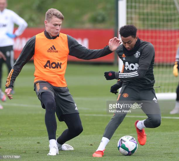 Brandon Williams and Jesse Lingard of Manchester United in action during a first team training session at Aon Training Complex on September 28 2020...