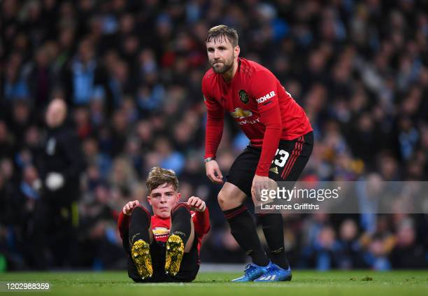 Brandon Williams and Luke Shaw of Manchester United look dejected during the Carabao Cup Semi Final match between Manchester City and Manchester...