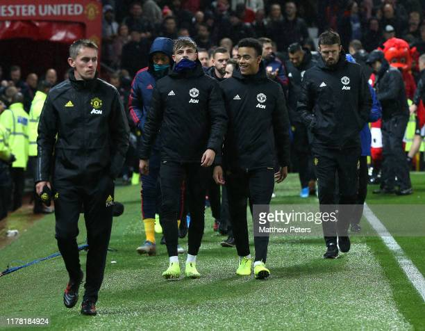 Brandon Williams and Mason Greenwood of Manchester United walk out ahead of the Premier League match between Manchester United and Arsenal FC at Old...