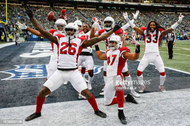 Brandon Williams and Zeke Turner and other members of the Arizona Cardinals celebrate after tying the score in the third quarter against the Seattle...