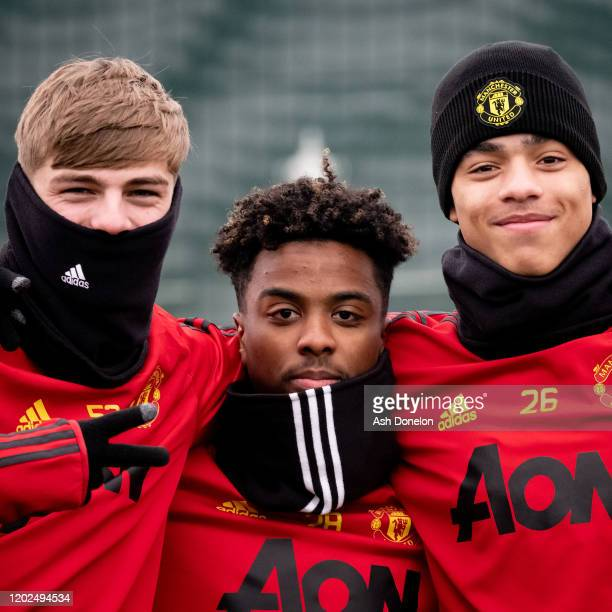 Brandon Williams, Angel Gomes and Mason Greenwood of Manchester United in action during a first team training session at Aon Training Complex on...