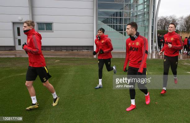 Brandon Williams, Jesse Lingard, Diogo Dalot, Phil Jones of Manchester United in action during a first team training session at Aon Training Complex...