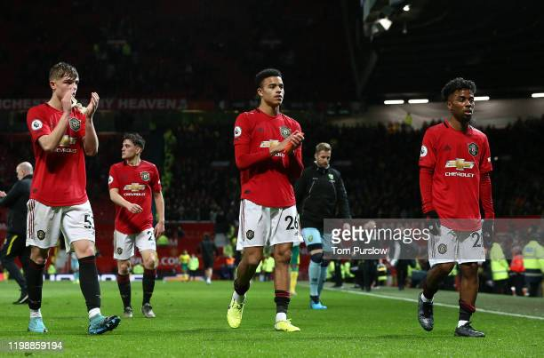Brandon Williams, Mason Greenwood and Angel Gomes of Manchester United walk off after the Premier League match between Manchester United and Norwich...