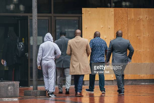 Brandon Williams, nephew of George Floyd, and Philonise Floyd and Rodney Floyd, brothers of George Floyd, enter the Hennepin County Government Center...