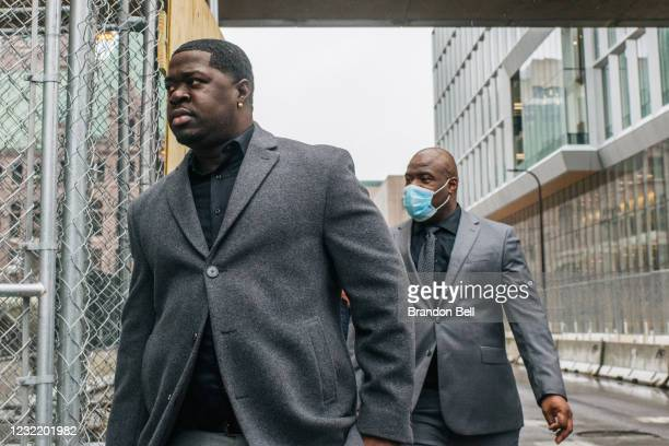 Brandon Williams , nephew of George Floyd, and Rodney Floyd , brother of George Floyd, check in at a security entrance at the Hennepin County...
