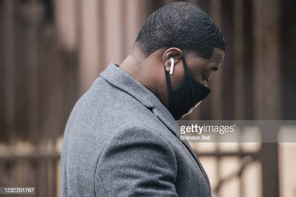 Brandon Williams, nephew of George Floyd, checks in at a security entrance at the Hennepin County Government Center on April 9, 2021 in Minneapolis,...