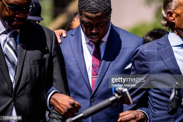 Brandon Williams , nephew of George Floyd, links arms in prayer outside the Hennepin County Government Center after the sentencing of Derek Chauvin...