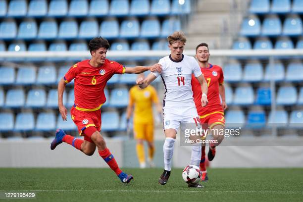 Brandon Williams of England runs with the ball under pressure from Joel Guillen of Andorra during the UEFA Euro U21 Qualifier between Andorra U21 and...
