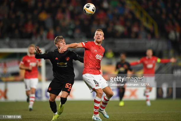 Brandon Williams of Manchester United and Dani de Wit of AZ Alkmaar compete for the ball during the UEFA Europa League group L match between AZ...