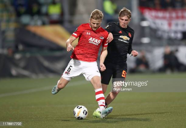 Brandon Williams of Manchester United battles for possession with Fredrik Midtsjo of AZ Alkmaar during the UEFA Europa League group L match between...