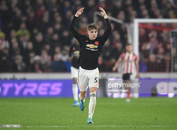 Brandon Williams of Manchester United celebrates after scoring his sides first goal during the Premier League match between Sheffield United and...