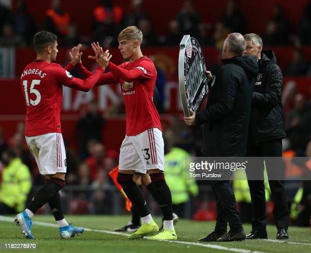 Brandon Williams of Manchester United comes on as a substitute for Andreas Pereira during the Premier League match between Manchester United and...