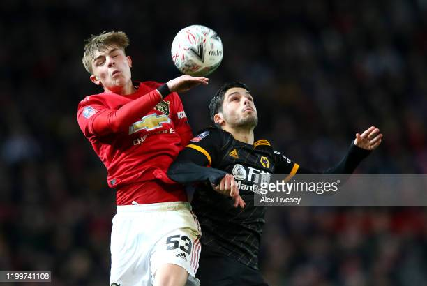 Brandon Williams of Manchester United heads the ball away from Pedro Neto of Wolverhampton Wanderers during the FA Cup Third Round Replay match...