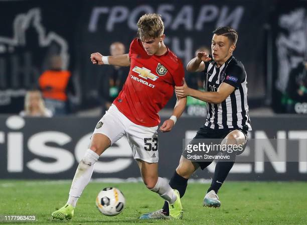 Brandon Williams of Manchester United in action against Filip Stevanovic of Partizan during the UEFA Europa League group L match between Partizan and...