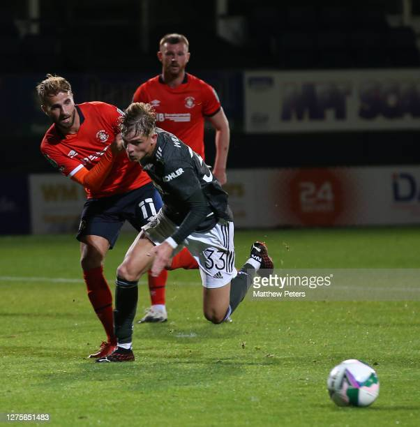 Brandon Williams of Manchester United in action with Andrew Shinnie of Luton Town during the Carabao Cup Third Round match between Luton Town and...
