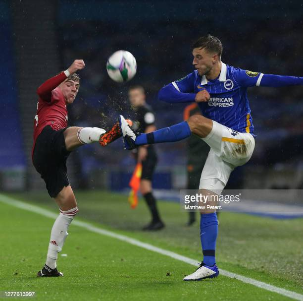 Brandon Williams of Manchester United in action with Joel Veltman of Brighton and Hove Albion during the Carabao Cup fourth round match between...
