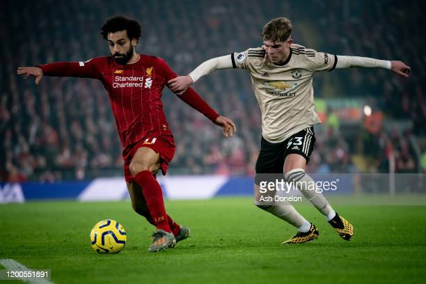 Brandon Williams of Manchester United in action with Mohamed Salah of Liverpool during the Premier League match between Liverpool FC and Manchester...
