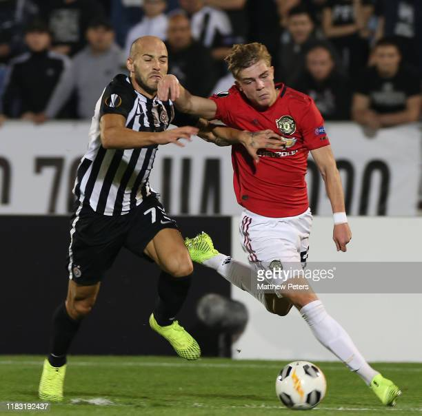 Brandon Williams of Manchester United in action with Nemanja Miletic of Partizan Belgrade during the UEFA Europa League group L match between...