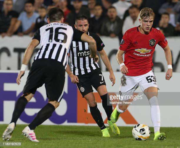 Brandon Williams of Manchester United in action with Zoran Tosic and Sasa Zdjelar of Partizan Belgrade during the UEFA Europa League group L match...