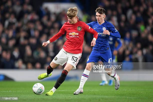 Brandon Williams of Manchester United is challenged by Billy Gilmour of Chelsea during the Carabao Cup Round of 16 match between Chelsea and...
