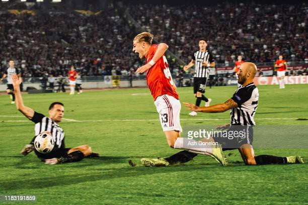 Brandon Williams of Manchester United is fouled by Nemanja Miletic of Partizan Belgrade and wins a penalty during the UEFA Europa League group L...