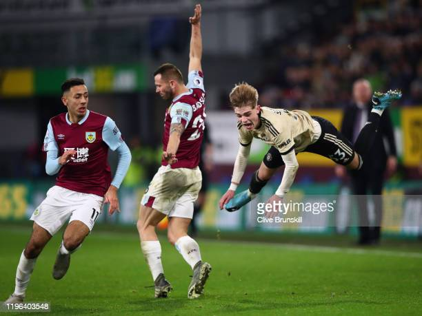 Brandon Williams of Manchester United is tackled by Phil Bardsley and Dwight McNeil of Burnley FC during the Premier League match between Burnley FC...