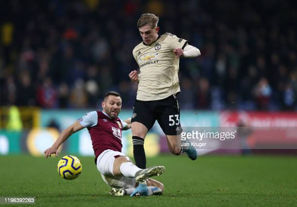 Brandon Williams of Manchester United is tackled by Phil Bardsley of Burnley FC during the Premier League match between Burnley FC and Manchester...