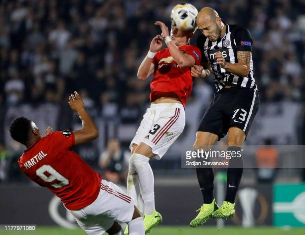Brandon Williams of Manchester United jump for the ball against Nemanja Miletic of Partizan during the UEFA Europa League group L match between...